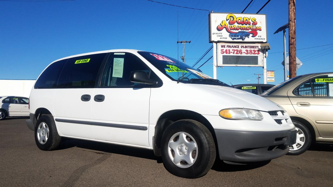 1999 White /Gray Dodge Caravan Base (2B4FP2535XR) with an 3.0L V6 SOHC 12V engine, AUTOMATIC transmission, located at 3477 Main St., Springfield, OR, 97478, (541) 726-3823, 44.045738, -122.976952 - Photo #0