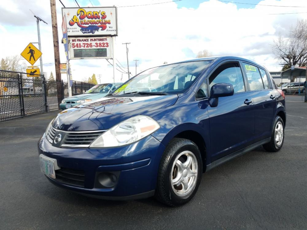 2009 Blue /Grey Nissan Versa 1.8 S Hatchback (3N1BC13E49L) with an 1.8L L4 DOHC 16V engine, Manual transmission, located at 3477 Main St., Springfield, OR, 97478, (541) 726-3823, 44.045738, -122.976952 - Photo #0