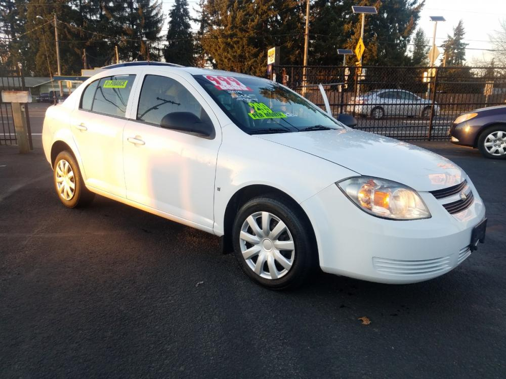 2010 White /Gray Chevrolet Cobalt LS Sedan (1G1AB5F59A7) with an 2.2L L4 DOHC 16V engine, 4-Speed Automatic transmission, located at 3477 Main St., Springfield, OR, 97478, (541) 726-3823, 44.045738, -122.976952 - Photo #0